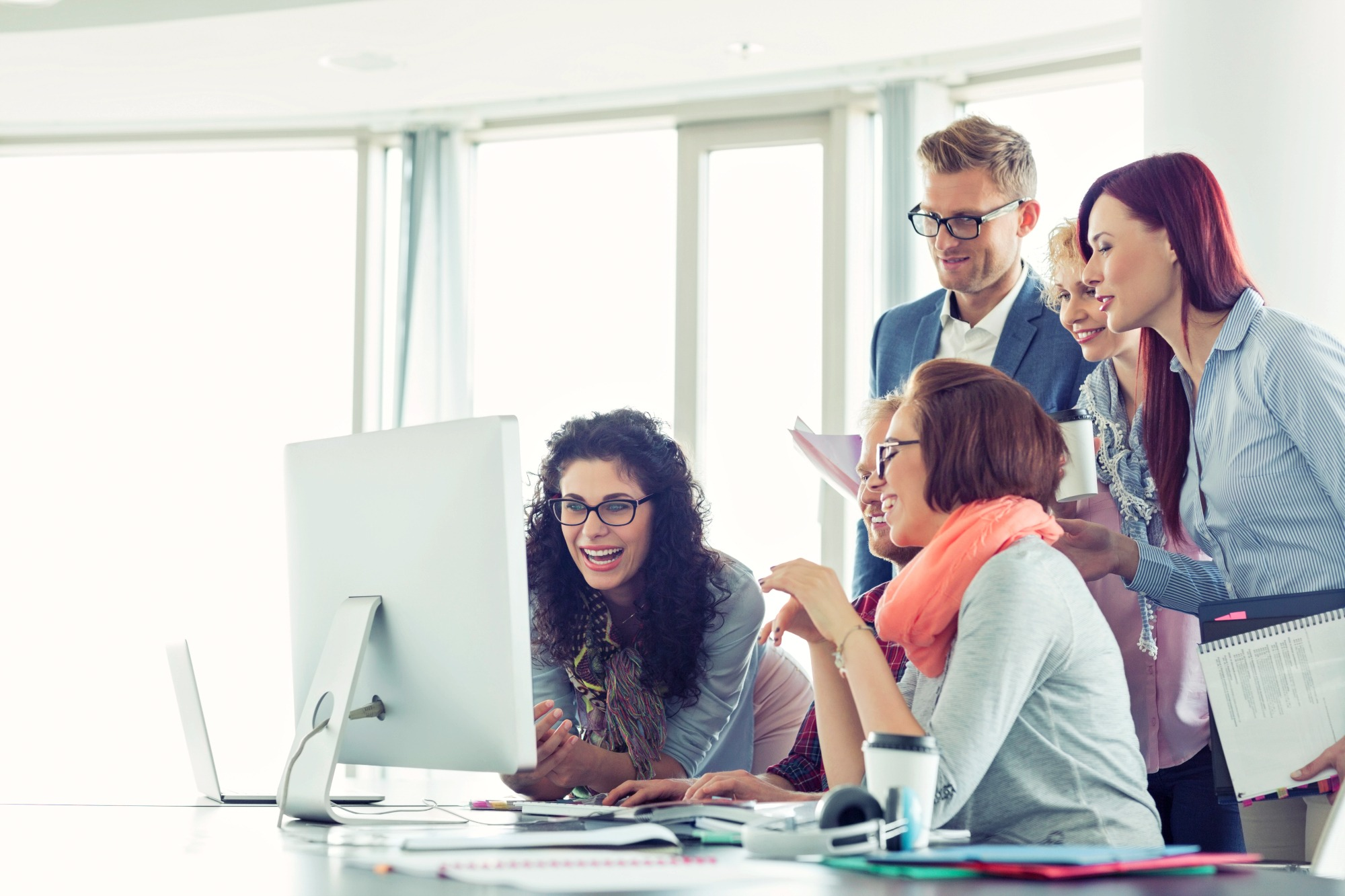 Smiling businesspeople working together at conference table